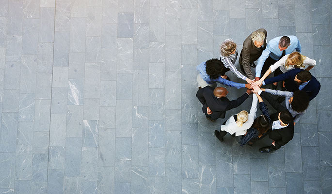 Overhead view of a group of people standing in a spiral