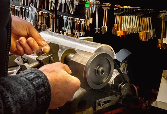 close-up of a man cutting keys in a hardware store